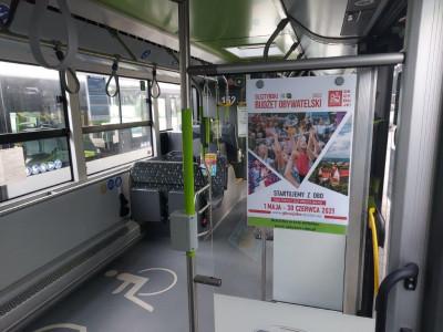 Plakaty OBO w autobusach